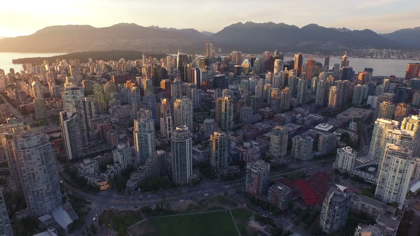 4K Aerial drone shot of Vancouver Skyline at sunset.