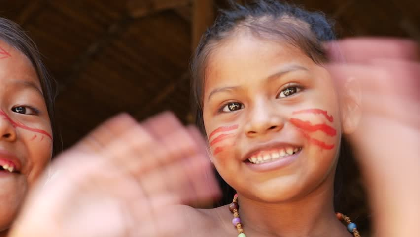 Cute native Brazilians having fun at an indigenous tribe in the Amazon