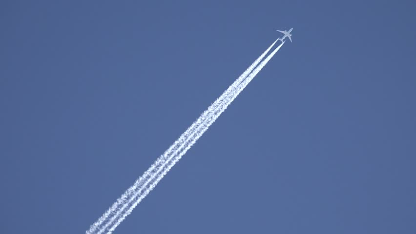 4K View of Airplane jet layer, aircraft pollution on sky, white trace vapour by day | Shutterstock HD Video #11778167