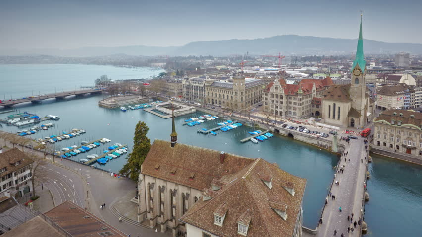 Aerial view on Fraumunster Church and the Limmat river from Grossmunster, Zurich, Switzerland, timelapse, UHD 4K