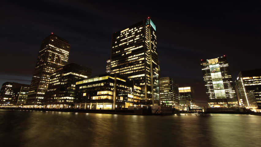 Time Lapse of London's Canary Wharf Financial District Office Buildings with River and Boat at Dusk, No  Trade Marks