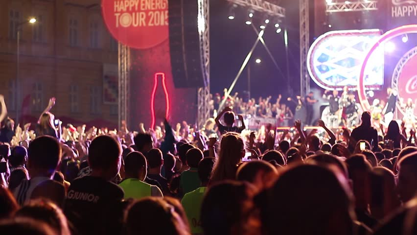 Sofia, Bulgaria - 20 September 2015: Free open air pop concert, crowd people jumping waving hands and shouting in spotlight #11883614