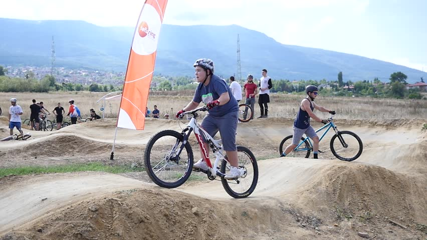 SOFIA, BULGARIA - SEP 24, 2015: Sport biking on the uneven track among young people | Shutterstock HD Video #11892479