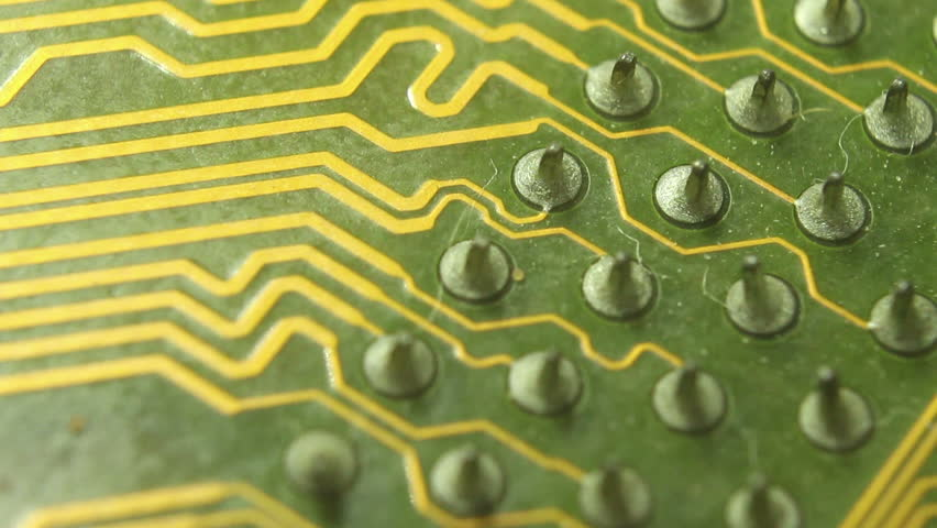 Super (10x) Macro Camera Dolly along a computer circuit board, moving slowly along soldered raised 'nipple' at the end of each circuit.  | Shutterstock HD Video #11895134