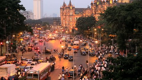 India - March 2015: Mumbai India Asia Chhatrapati Shivaji Terminus Victoria Terminus Maharashtra State CST sunset illuminated railway travel