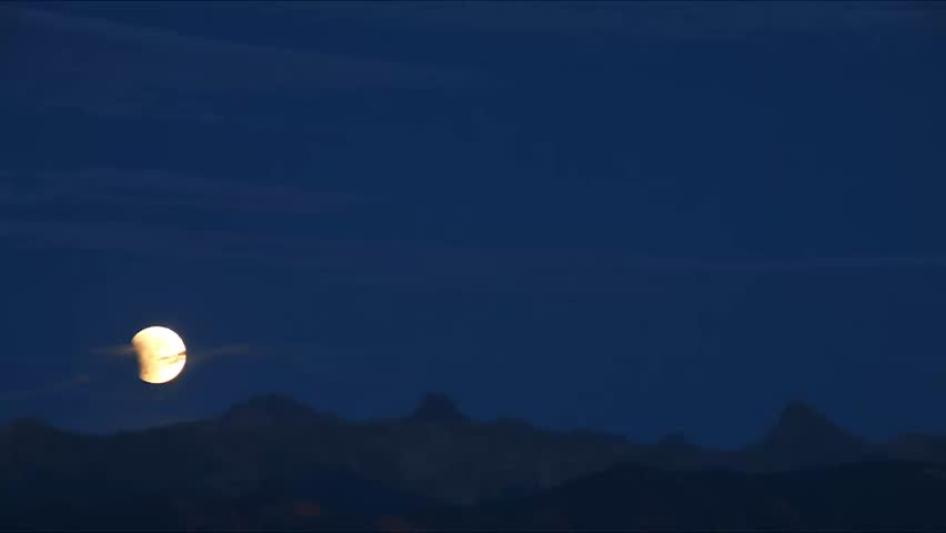 First phase of Total Lunar Eclipse of a Supermoon on September 27, 2015 in Colorado, USA. It is the latter of two total lunar eclipses in 2015, and the final in a tetrad.