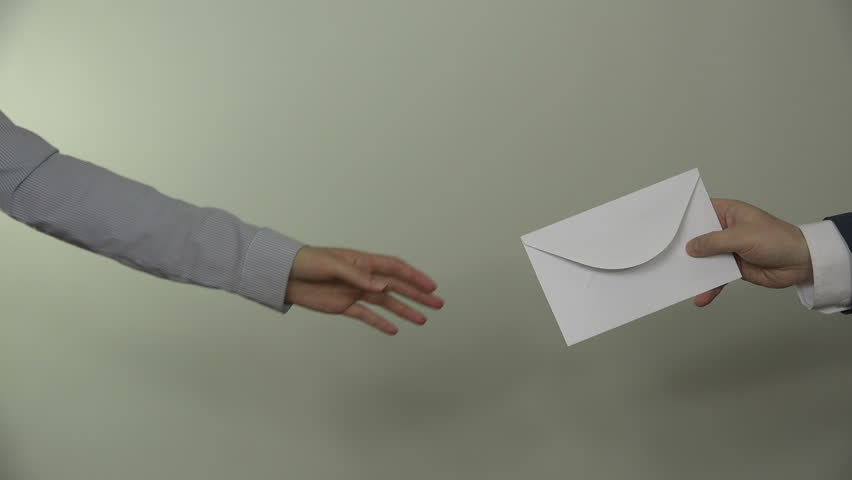 People hands exchange envelope on white background. Male man in suit give envelope gift for business partner woman. Bribery in government. Closeup shot. 4K UHD video clip.