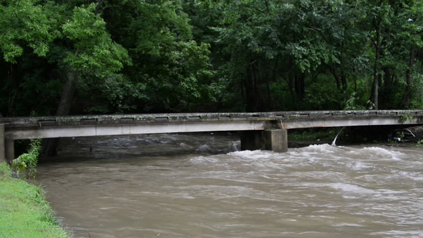 Pan Beargrass Creek flood. Small bridge 1080p with natural sound. | Shutterstock HD Video #11995514