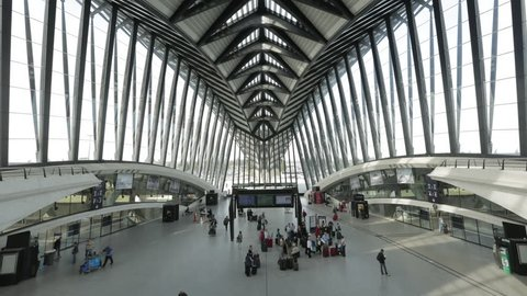 Lyon Saint-Exupery Airport. Hall of the TGV French High speed train inside the airport. Lots of travelers continue their travel by train after their plane.