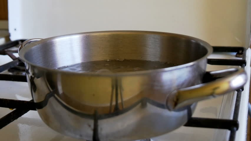 Boiling water in a kitchen pot as a symbol of cooking or food preparation and sterilization of contaminated tap water for healthy pure drinking liquid.  | Shutterstock HD Video #12017684
