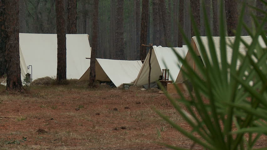 FLORIDA - FEBRUARY 2015 - large-scale epic Civil War 150th anniversary reenactment & Civil War Era Tent And Supplies With Some Campfire Smoke Stock ...