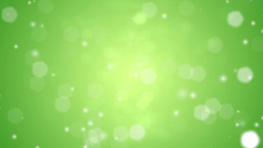 Defocused lights falling like snow from above against a green background. Looping video.