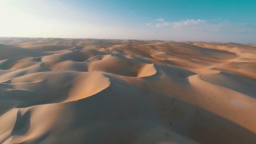 Flying over barren red sandy desert