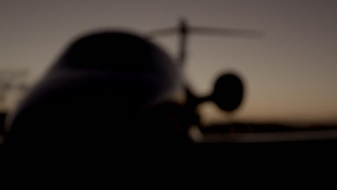 Blur in night shot of airport parked private jet (Cessna Citation IV)