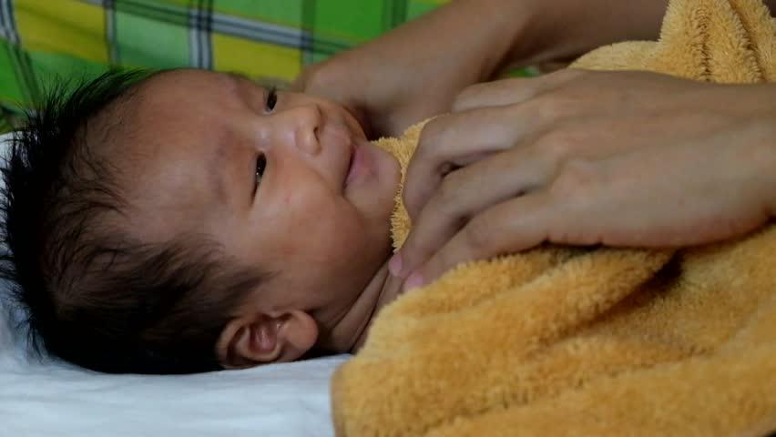 Stock video of little newborn baby having a bath | 13852943 ...