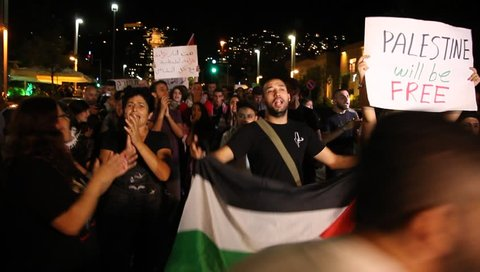 HAIFA, ISRAEL - OCTOBER 05, 2015: Pro Palestinian Arab Israelis protest with PLO flags against conflict escalation in Temple Mount, for Palestinian state and terror, confirm and promote 3rd Intifada.
