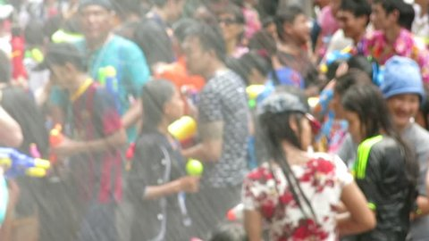 Bangkok, Thailand – April 14, 2014: People play water in Songkran Festival. One of the main activities to celebrate Thai traditional New Year is throwing or sprinkling water at each other.