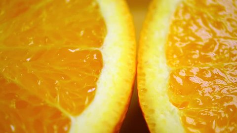 Dolly shot of orange halves, macro video