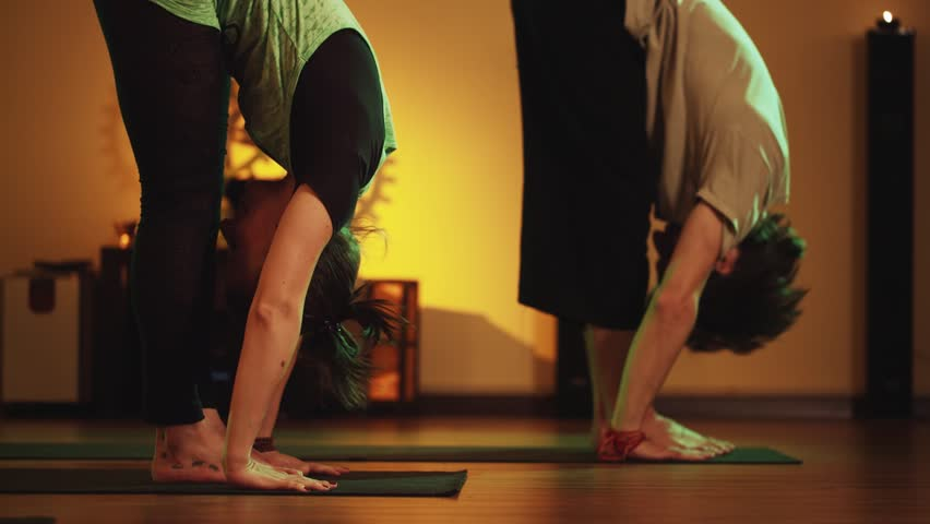 Group yoga Class in a cozy room with candles. Soft and warm subdued lighting | Shutterstock HD Video #12160514
