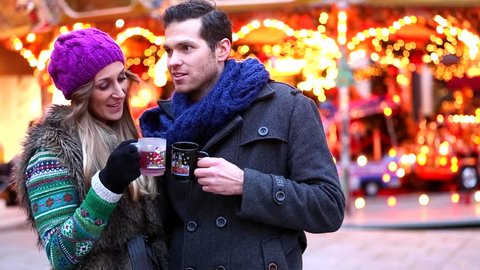 Couple drinking mulled wine on Christmas Market
