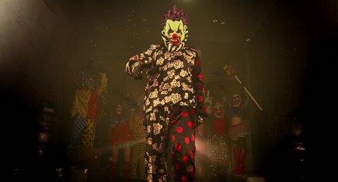A group of clowns. Two clown acrobat dance break dance. Halloween party.