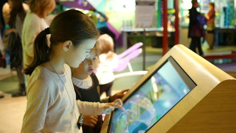 SOFIA, BULGARIA - OCT 02, 2015: Open doors in new cognitive museum for children - kids view and play with multimedia displays and playground educative stands