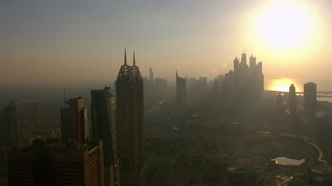 WS AERIAL View of Dubai city and sky scrapper at sunset / Dubai, United Arab Emirates