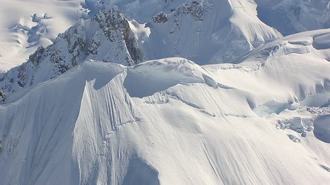MS AERIAL TS Shot of avalanche on summit of Tordrillo snowy mountain range / Alaska, United States