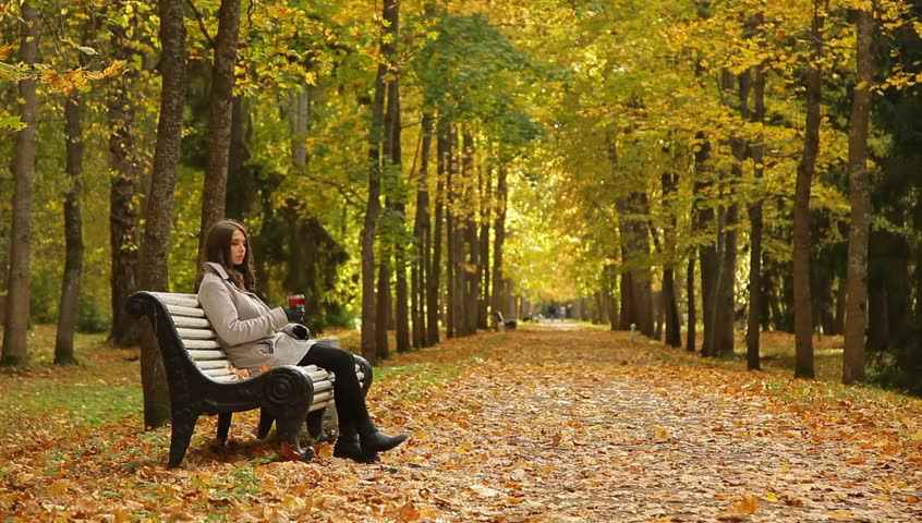 Autumn Scene Athlete Man Seated On A Park Bench Taking A
