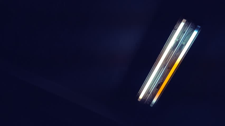 Neon fluorescent lighting, neon light glass tubes turning on and off, 4k 2160p uhd footage.