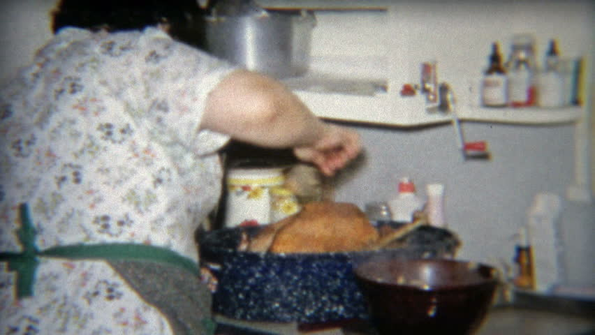 FLINT, MICHIGAN 1964: Grandma cooking Thanksgiving dinner, adults and kids table.