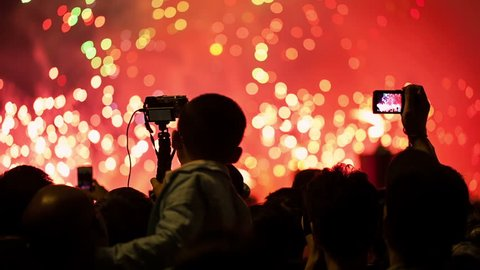 """Watching Fireworks silhouetted crowd. Holiday backgrounds. Fireworks in the sky celebrating lunar new year... >>> Please search more: """" FireworksCollection """"."""