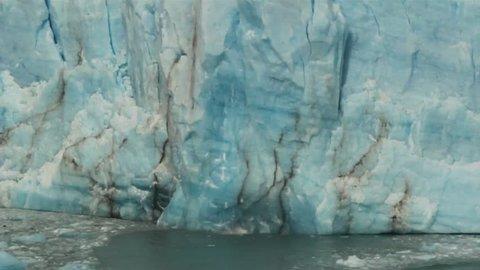 Falling iceberg at Perito Moreno glacier in National Park Glaciares, Argentina