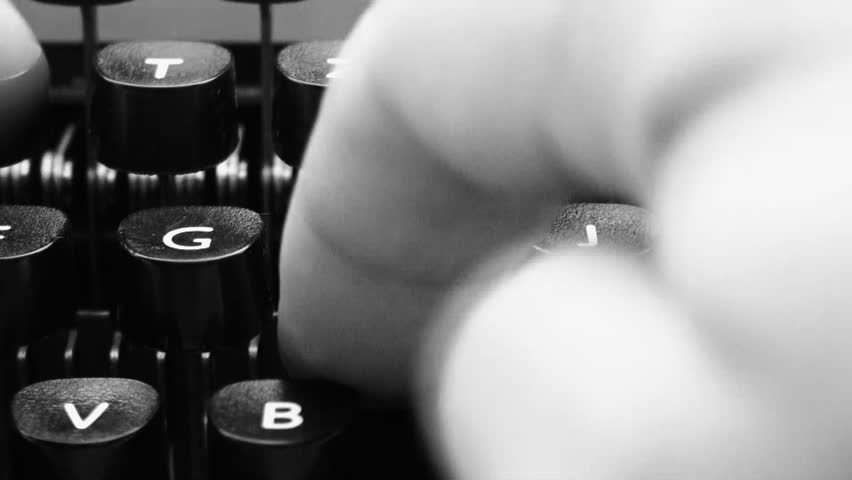 fingers on a typewriter
