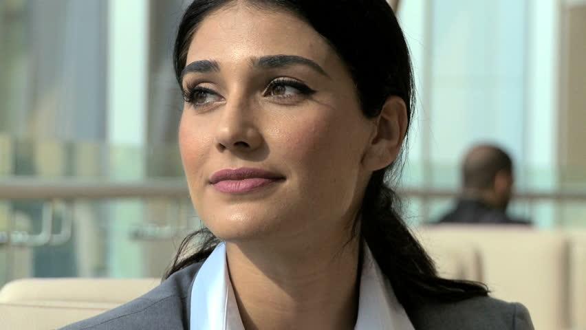 Western European brunette woman coffee business Dubai corporate insurance commercial commodity oil trade growth advisor coffee | Shutterstock HD Video #12325424