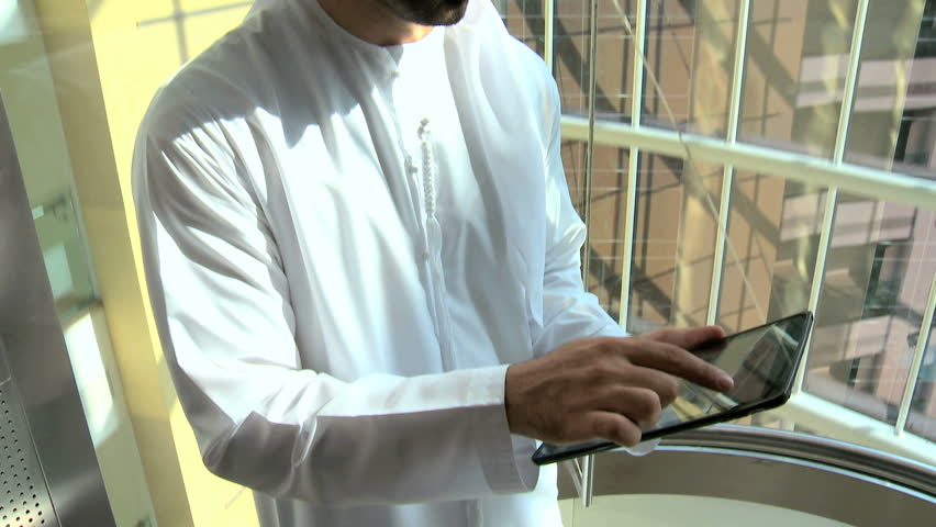 Arab business male city hotel elevator travel technology tablet cloud device