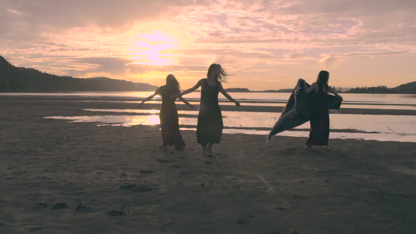 3 Friends Dance And Twirl In Circles Around Beach At Sunset (Slow Motion) | Shutterstock HD Video #12332504