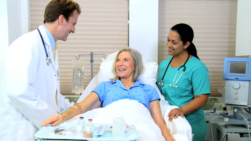 Medical Staff Using Tablet For Care Plan Senior Female Patient Stock Footage Video -7934