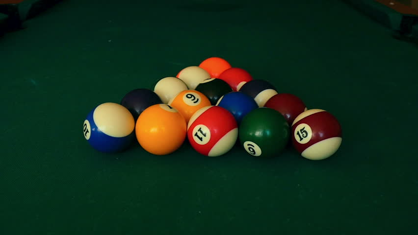 The billiard ball ricocheted in a billiard pocket, slow motion