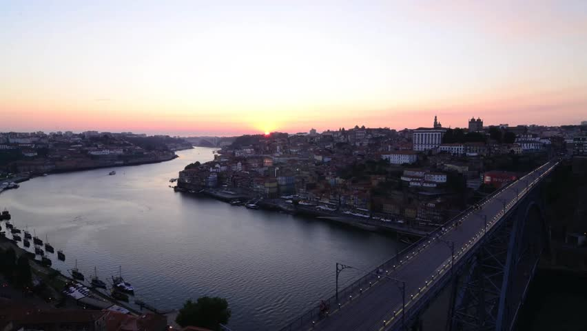 Time lapse of sunset on Dom Luis I bridge in Porto, Portugal.