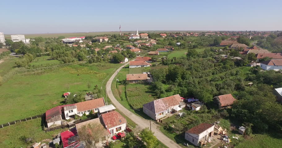 Aerial village in Romania with landmark, church and school