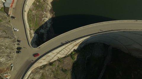 4K aerial shot of Vidraru Dam and Lake Vidraru on Transfagarasan – one of the highest altitude mountain roads in Romania