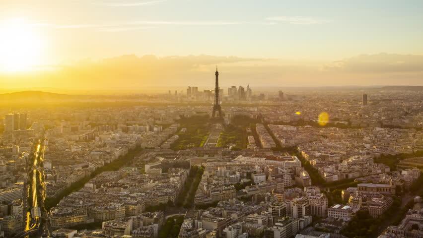 Paris - August 3rd, 2013: Time lapse footage of sunset over Eiffel Tower seen from Tour Montparnasse (Montparnasse 56), Paris, France | Shutterstock HD Video #12433094