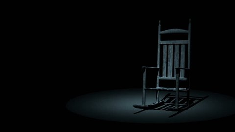 Spooky Rocking Chair On Dark Background