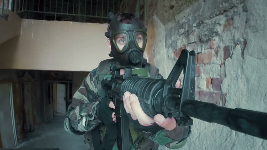 Soldier securing location with rifle mounted camera. This video is part of a set featuring a soldier in an abandoned school. Be sure and check the other videos to find the ones you are looking for. #12473774