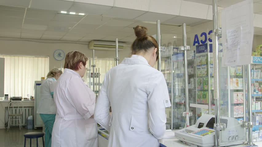 SIMFEROPOL, RUSSIA - CIRCA OCTOBER 2015: Customers buying medicines at russian pharmacy drugstore  #12502154