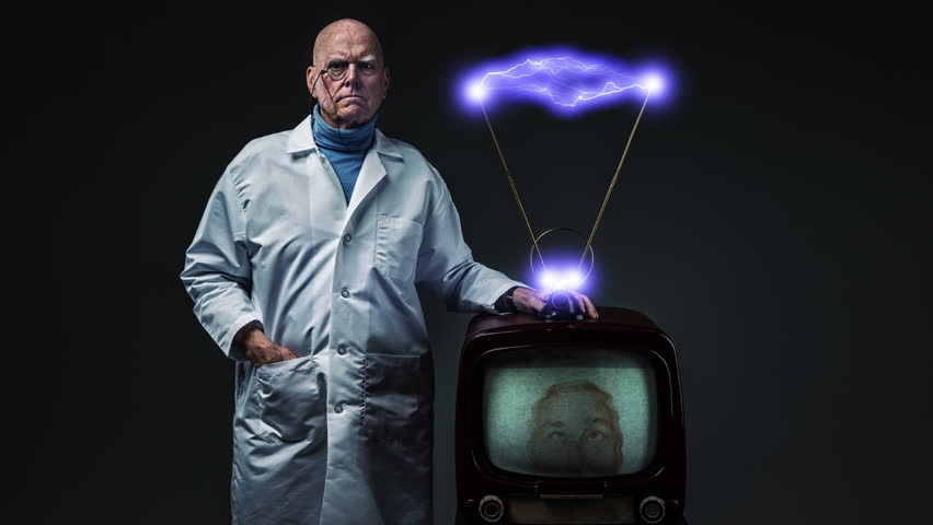 Evil genius in white lab coat standing next to vintage television with electrified rabbit ear antennae