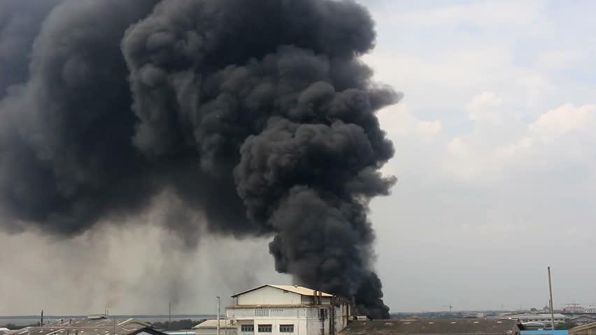 Massive Black Smoke From A Building Far Away Wide Shot