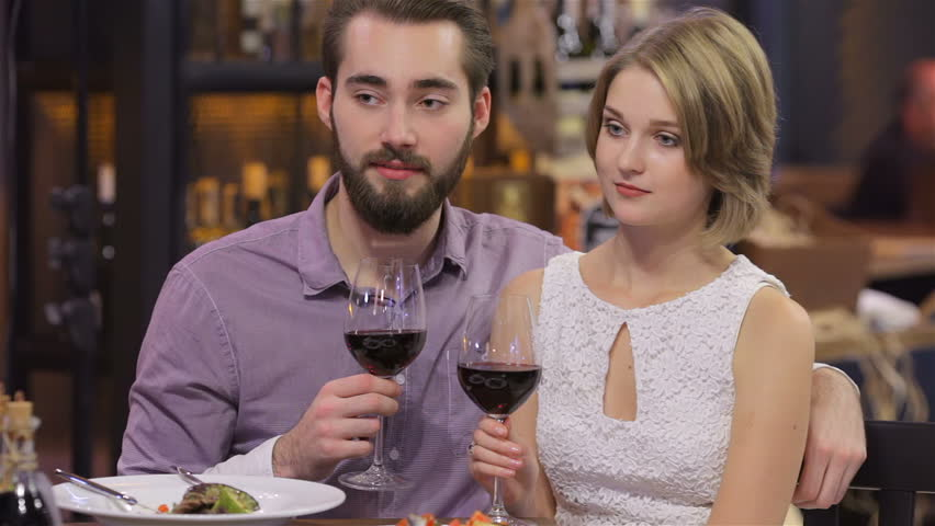 Happy Couple At Restaurant After He Propose Marriage To Her