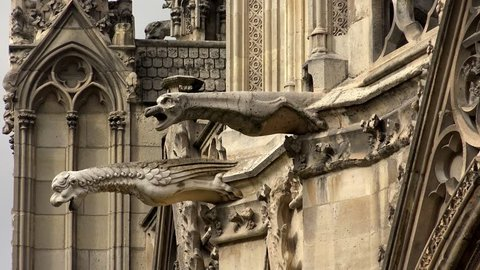 Gargoyles watch over Paris, France from Notre Dame cathedral. Shot in 4K (ultra-high definition (UHD)).